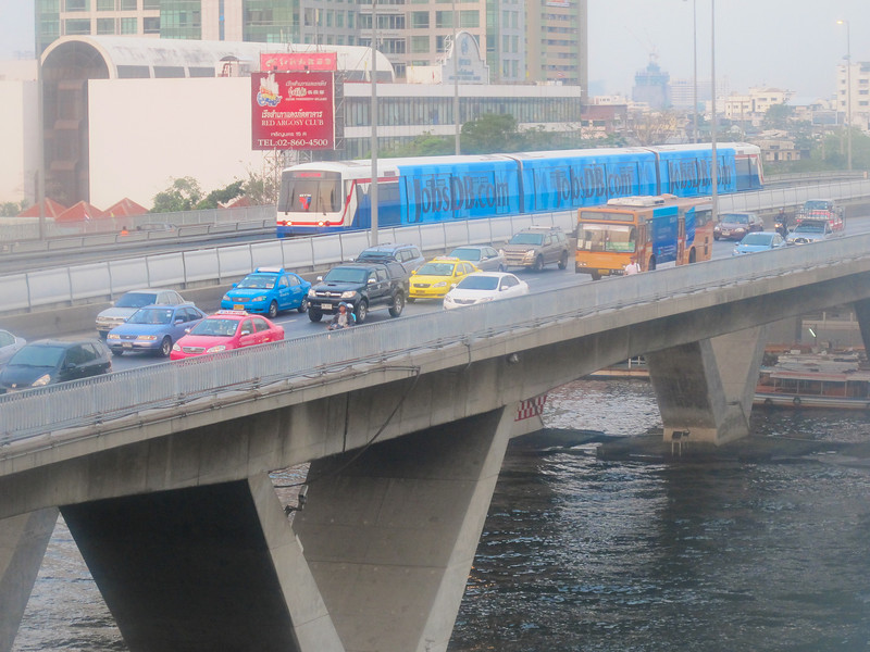 Rush hour on the bridge into town over the Chao Phraya River, Bangkok, Thailand.