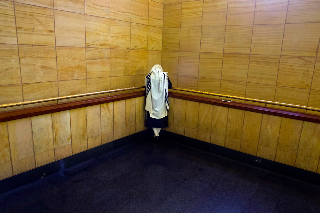 . An ultra-Orthodox Jewish man prays inside the Belz yeshiva in Jerusalem, Wednesday, Sept. 25, 2013 during the Jewish holiday of Sukkot. The holiday commemorates the biblical story of the Israelites 40 years of wandering in the desert. (AP Photo/Bernat Armangue)