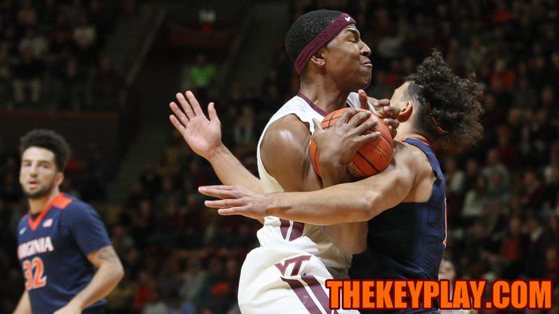 Zach Leday draw a blocking foul from UVA's Anthony Gill in the first half. (Mark Umansky/TheKeyPlay.com)