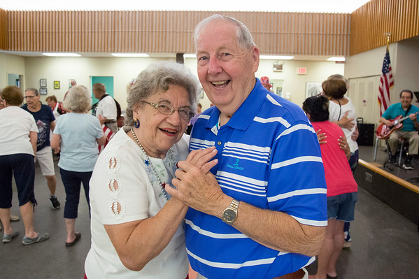 07/03/19 Wesley Bunnell | Staff The New Britain Senior Center was the scene for a 4th of July Red White & Boom Party presented by Autumn Lake on Wednesday July 3, 2019. The event featured food, raffle items and a live band. Pat Tomasso and Bob Northam dance while the band plays.