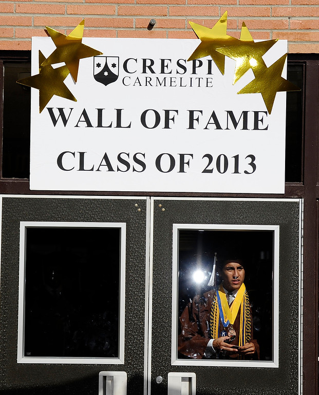 . Grads look to see if there parents arriving in time of the Crespi High class of 2013 graduation. May 24.2013.  Photos by Gene Blevins/LA DailyNews