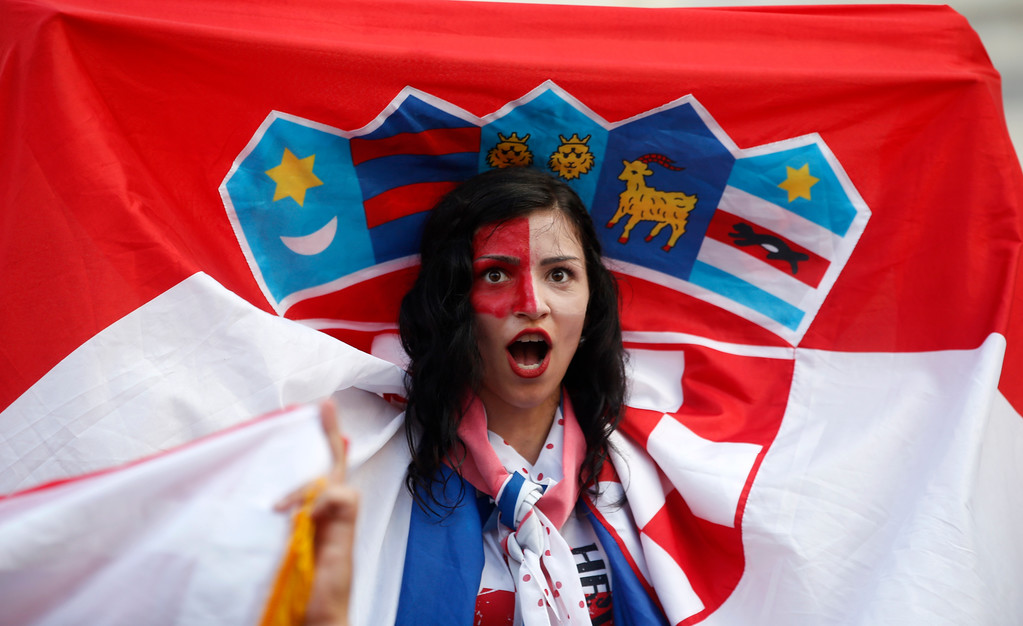 . A Croatian soccer fan cheers as they watch a television broadcast of the Russia 2018 World Cup match between France and Croatia in downtown Zagreb, Croatia, Sunday, July 15, 2018. (AP Photo/Darko Vojinovic)