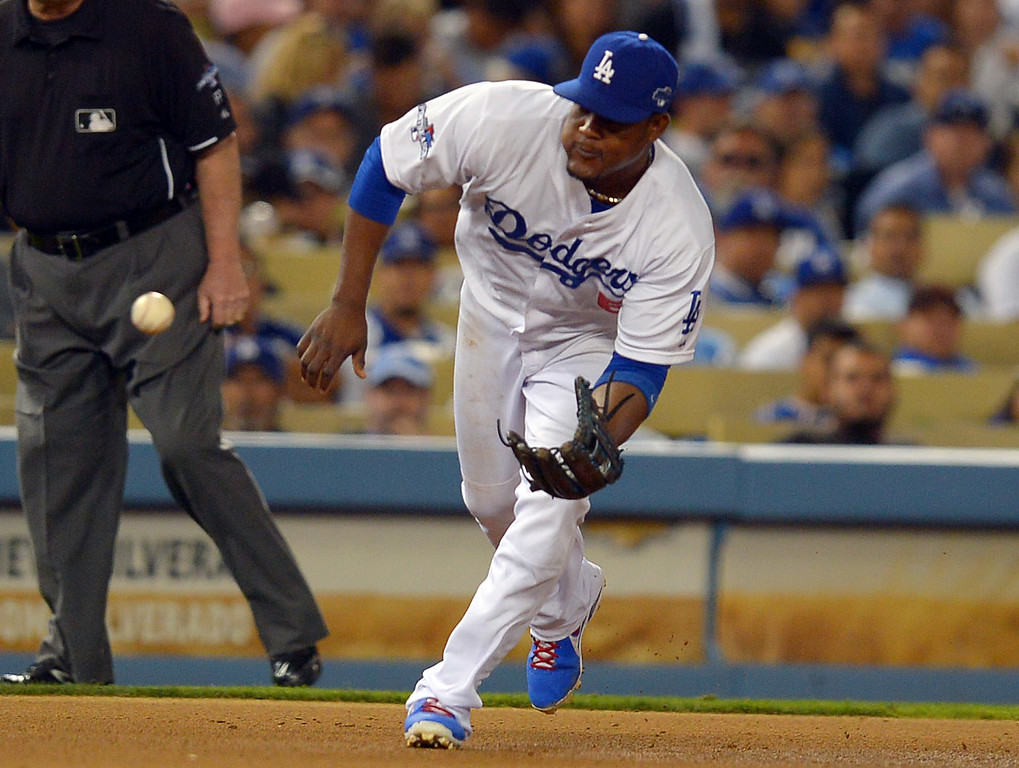 . The Dodgers\' Juan Uribe fields a ground ball against the Cardinals during game 4 of the NLCS at Dodger Stadium Tuesday, October 15, 2013. (Photo by Andy Holzman/Los Angeles Daily News)