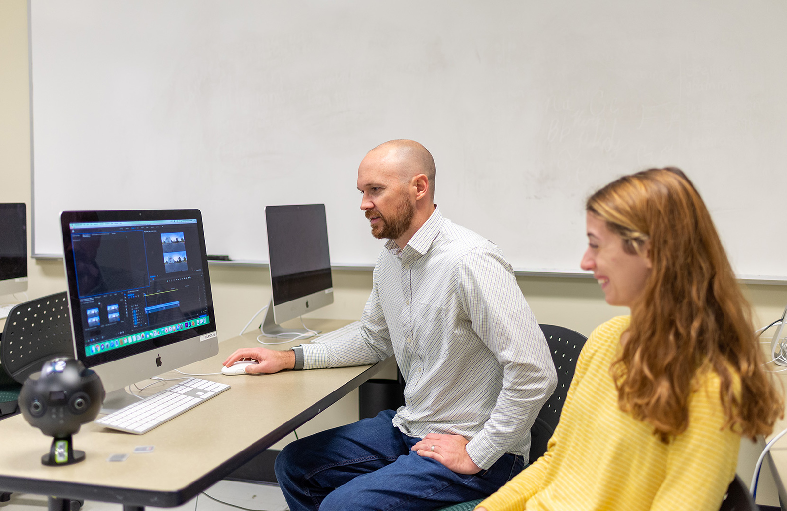 Graduate student Hannah Jones (right) works with Greer on the Virtual Reality Georgia project.