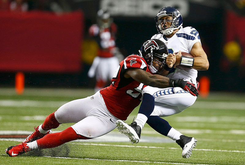 . Seattle Seahawks quarterback Russell Wilson is tackled by Atlanta Falcons middle linebacker Akeem Dent during the second quarter in their NFL NFC Divisional playoff football game in Atlanta, Georgia January 13, 2013. REUTERS/Chris Keane