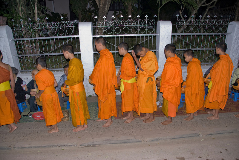 Young monks participating in alms giving ceremony in Luang Prabang, Laos