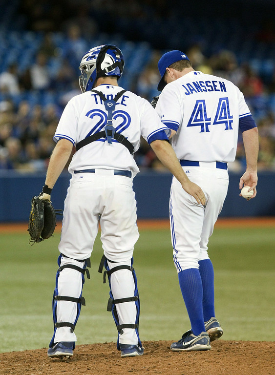 . Toronto Blue Jays catcher Josh Thole goes out to talk to pitcher Casey Janssen after Janssen gave up three runs and the lead to the Detroit Tigers in the ninth inning of a baseball game, Friday, Aug. 8, 2014 in Toronto. (AP Photo/The Canadian Press, Fred Thornhill)