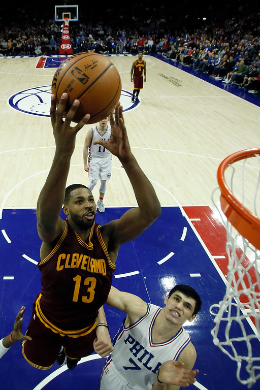 . Cleveland Cavaliers\' Tristan Thompson (13) goes up for a shot against Philadelphia 76ers\' Ersan Ilyasova (7) during the second half of an NBA basketball game, Sunday, Nov. 27, 2016, in Philadelphia. Cleveland won 112-108. (AP Photo/Matt Slocum)