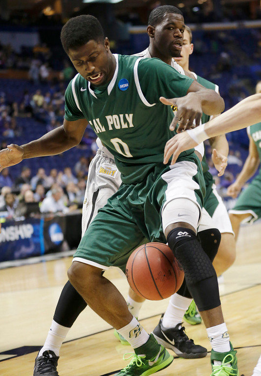 . Cal Poly guard/forward Dave Nwaba (0) loses the ball as Wichita State forward Chadrack Lufile (0) defends during the first half of a second-round game in the NCAA college basketball tournament Friday, March 21, 2014, in St. Louis. (AP Photo/Charlie Riedel)