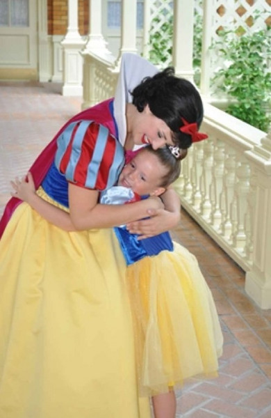 kate hugging Snow White after makeover.jpg