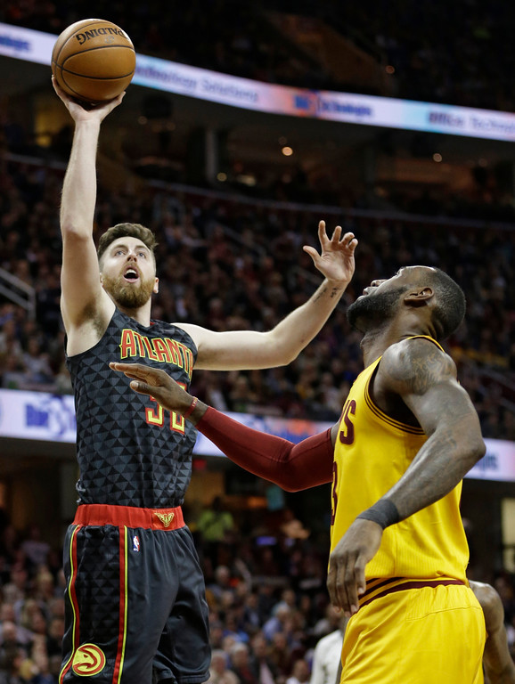 . Atlanta Hawks\' Ryan Kelly (30) shoots over Cleveland Cavaliers\' LeBron James (23) in the first half of an NBA basketball game, Friday, April 7, 2017, in Cleveland. (AP Photo/Tony Dejak)