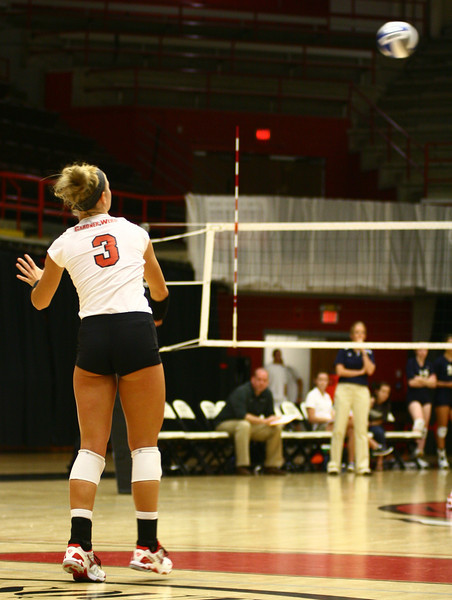 Lauren Evans, 3, serves to the other team.