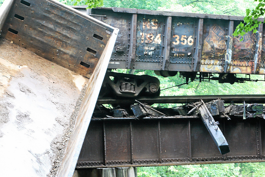 . Two cars lay off a bridge into the Brandywine Creek following a train derailment in Valley, Chester County, on Monday, July 8, 2013.