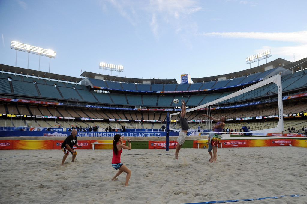 . People play beach volleyball before the 2014 NHL Stadium Series featuring the Los Angeles Kings taking on the Anaheim Ducks at Dodger Stadium January 25, 2014. (Photo by Hans Gutknecht/Los Angeles Daily News)