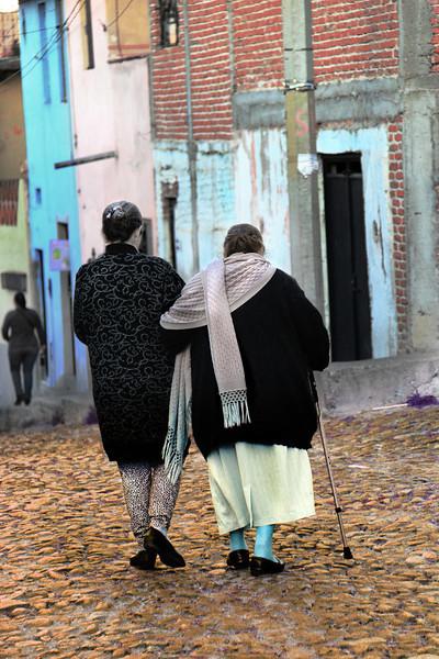 women walking arm n arm.jpg