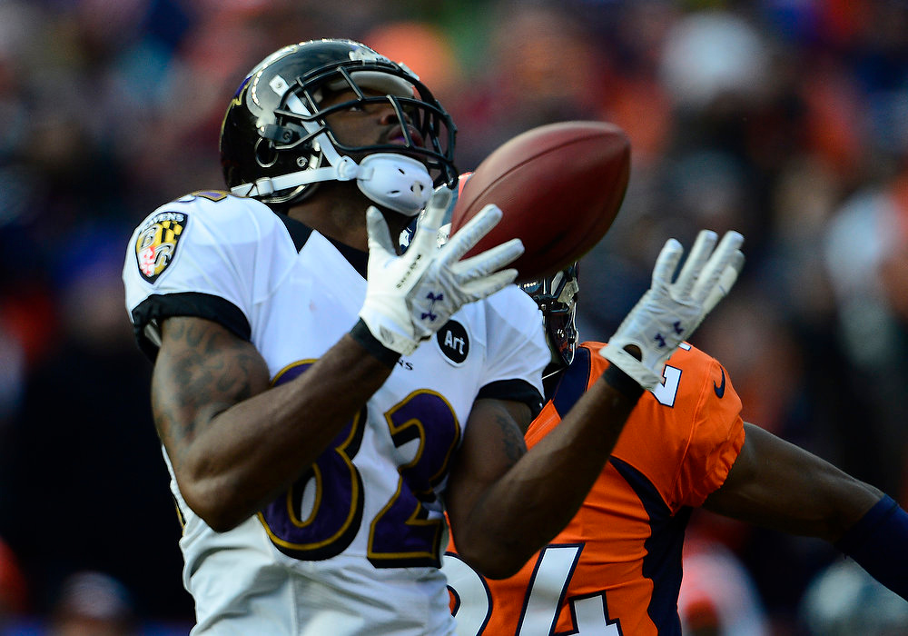Description of . Baltimore Ravens wide receiver Torrey Smith (82) makes a catch for a 59-yard touchdown in the first quarter. The Denver Broncos vs Baltimore Ravens AFC Divisional playoff game at Sports Authority Field Saturday January 12, 2013. (Photo by AAron  Ontiveroz,/The Denver Post)