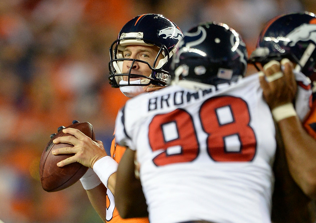 . DENVER, CO - AUGUST 23: Denver Broncos quarterback Peyton Manning (18) looks down field to pass as he gets rushed by Houston Texans defensive end Keith Browner (98) during the second quarter August 23, 2014 at Sports Authority Field at Mile High Stadium. (Photo by John Leyba/The Denver Post)