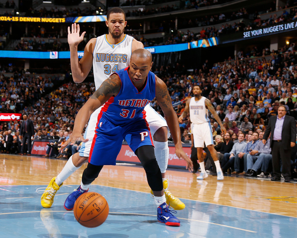 . Detroit Pistons guard Caron Butler, front, reaches out to pick up loose ball as Denver Nuggets center JaVale McGee looks on in the fourth quarter of the Nuggets\' 89-79 victory in an NBA basketball game in Denver on Wednesday, Oct. 29, 2014. (AP Photo/David Zalubowski)