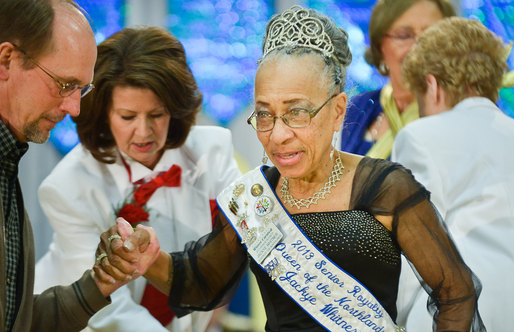 . The outgoing 2013 Queen of the Northlands, Jackye Whitner, is helped off the stage at the conclusion of the Senior Royalty Coronation ceremony. (Pioneer Press: Ben Garvin)