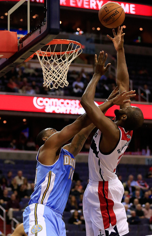 . Chris Singleton #31 of the Washington Wizards puts up a shot against Darrell Arthur #00 of the Denver Nuggets during the second quarter at Verizon Center on December 9, 2013 in Washington, DC.  (Photo by Rob Carr/Getty Images)
