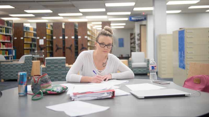Caroline Cutbirth studies for the upcoming DAT exam at the Mary and Jeff Bell Library.