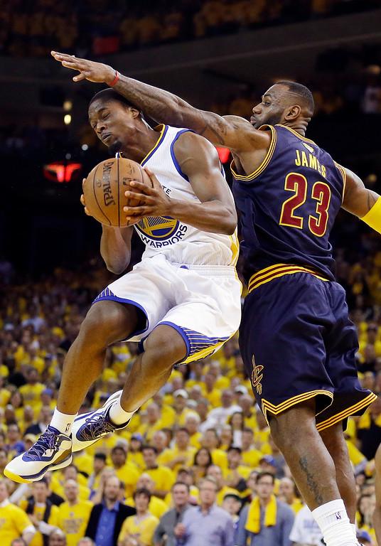 . Golden State Warriors forward Harrison Barnes, left, shoots against Cleveland Cavaliers forward LeBron James during overtime of Game 1 of basketball\'s NBA Finals in Oakland, Calif., Thursday, June 4, 2015. The Warriors won 108-100. (AP Photo/Ben Margot)