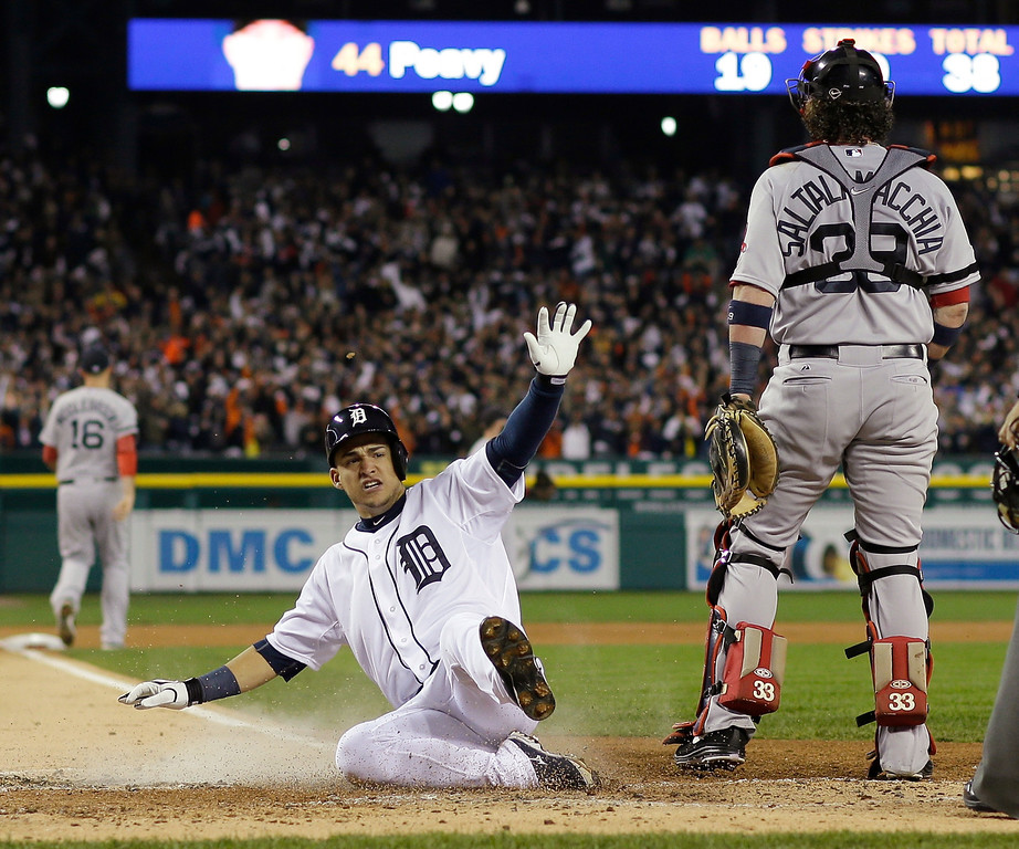 . Detroit Tigers\' Jose Iglesias scores on a double by Torii Hunter in the second inning during Game 4 of the American League baseball championship series Wednesday, Oct. 16, 2013, in Detroit. (AP Photo/Matt Slocum)