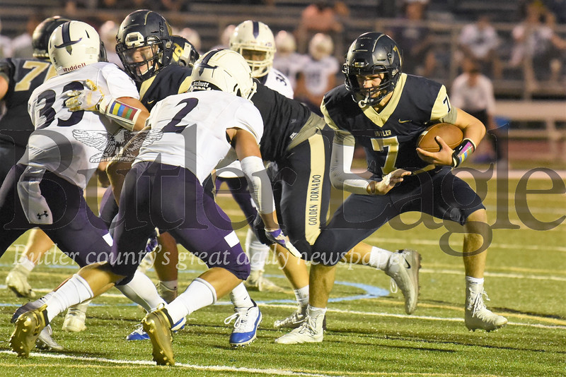 Butler quarterback Cooper Baxter breaks for a hole on a quarterback keeper during the Golden Tornado's  second quarter scoring drive. Butler fell to Baldwin 42-21 Friday night. Seb Foltz/Butler Eagle