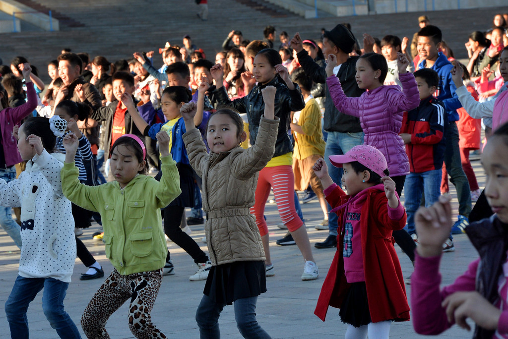 . This photo taken on on May 31, 2013, Mongolian children dance outside the Parliament building during events to celebrate International Children\'s Day in Ulan Bator, Mongolia.  Mongolia along with current and former Communist countries celebrates their Children\'s Day on June 1. MARK RALSTON/AFP/Getty Images