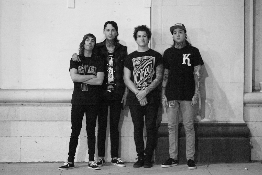 Pierce The Veil outside of their bus right before heading to stage