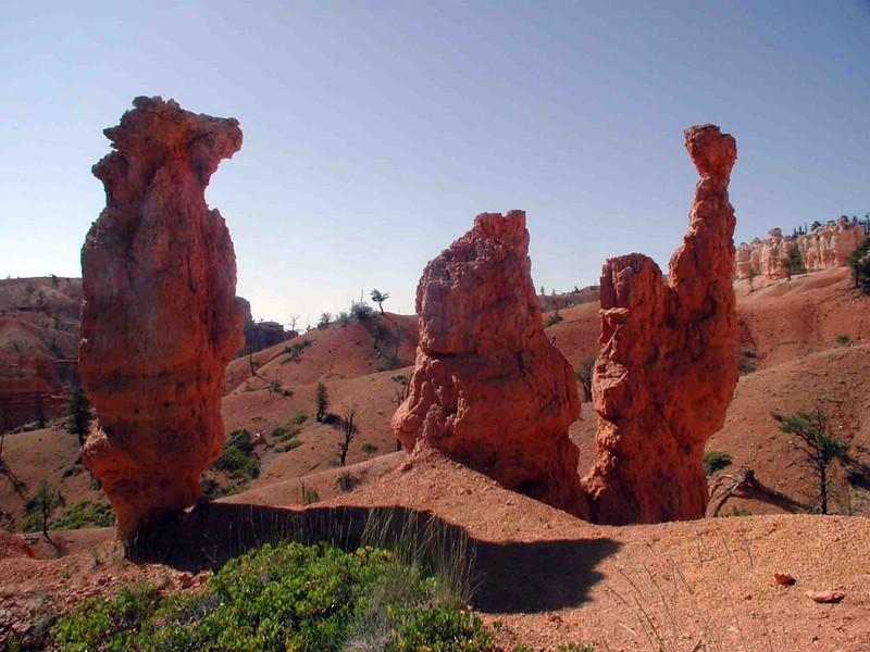 HOODOO SENTINALS It struck me funny that these three guys should just be standing around here, as if on watch -- or perhaps resting! I know how you feel, guys.