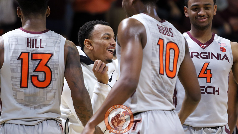 Justin Robinson does a small dance as he greets his teammates from the bench after a foul. (Mark Umansky/TheKeyPlay.com)