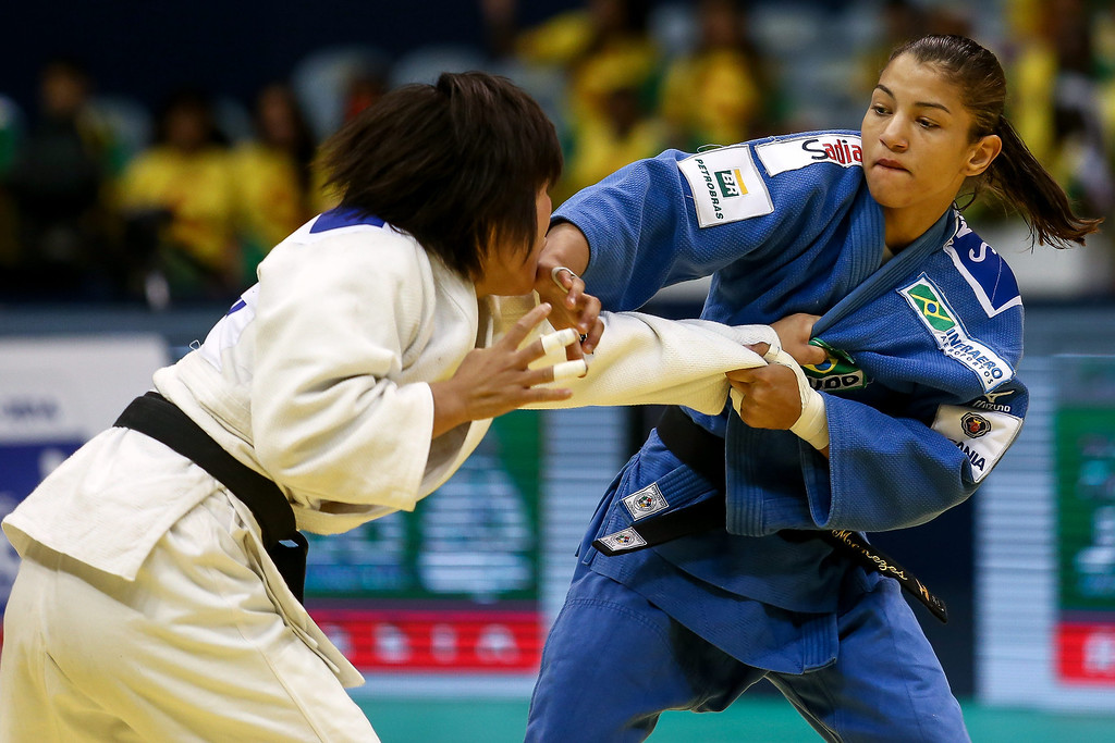 . RIO DE JANEIRO, BRAZIL - AUGUST 26: Sarah Menezes of Brazil (blue) fights against Sol Mi Kim of Korea in the -48 kg category during the World Judo Championships at the Maracanazinho gymnasium on August 26, 2013 in Rio de Janeiro, Brazil. (Photo by Buda Mendes/Getty Images)