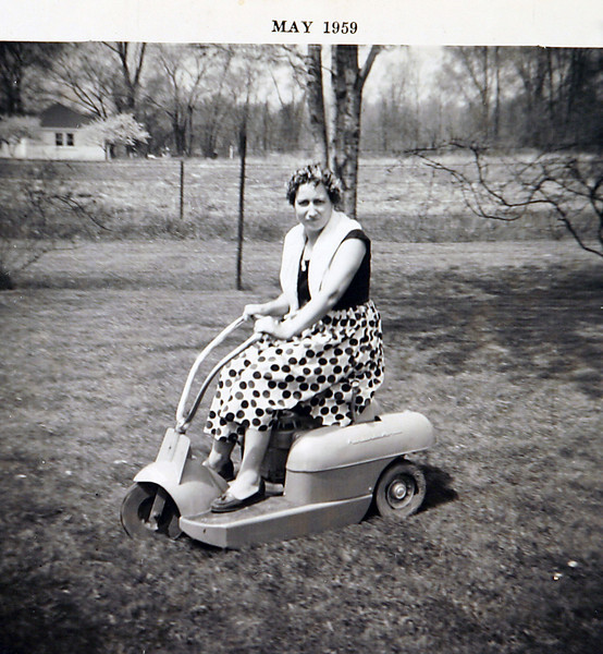 Aunt Lil mowing the lawn.JPG