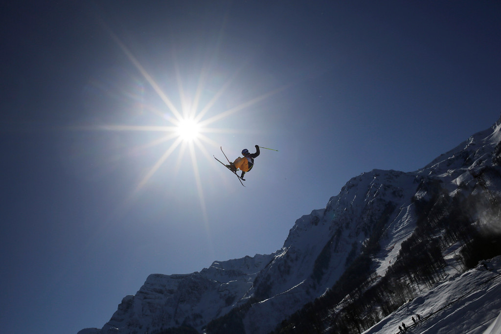 . A competitor takes a jump during a ski slopestyle training session at the Rosa Khutor Extreme Park, prior to the 2014 Winter Olympics, Tuesday, Feb. 4, 2014, in Krasnaya Polyana, Russia. (AP Photo/Andy Wong)