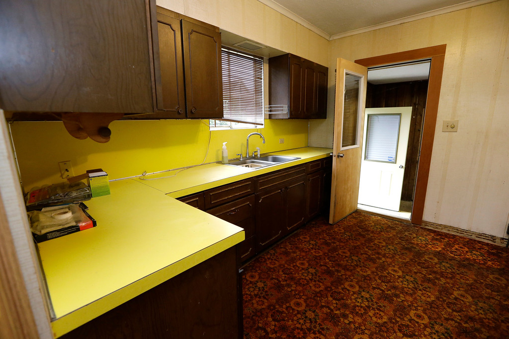 . This photo taken Monday, Sept. 23, 2013, shows the kitchen of the childhood home of Kurt Cobain, the late frontman of Nirvana, in Aberdeen, Wash.  (AP Photo/Elaine Thompson)