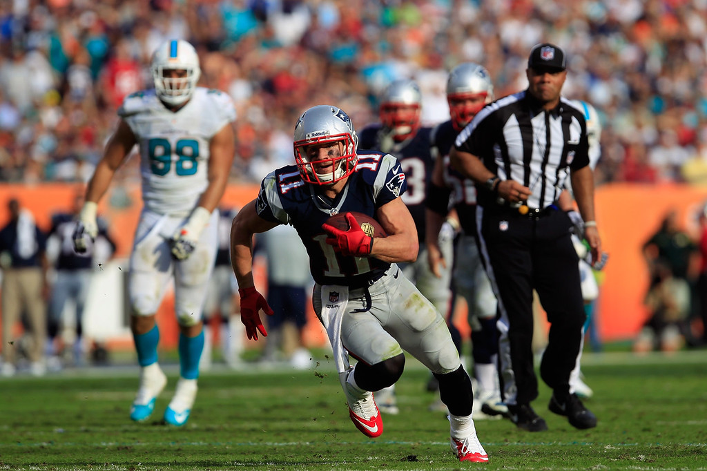 . Julian Edelman #11 of the New England Patriots runs for a touchdown in the fourth quarter against the Miami Dolphins at Sun Life Stadium on December 15, 2013 in Miami Gardens, Florida.  (Photo by Chris Trotman/Getty Images)