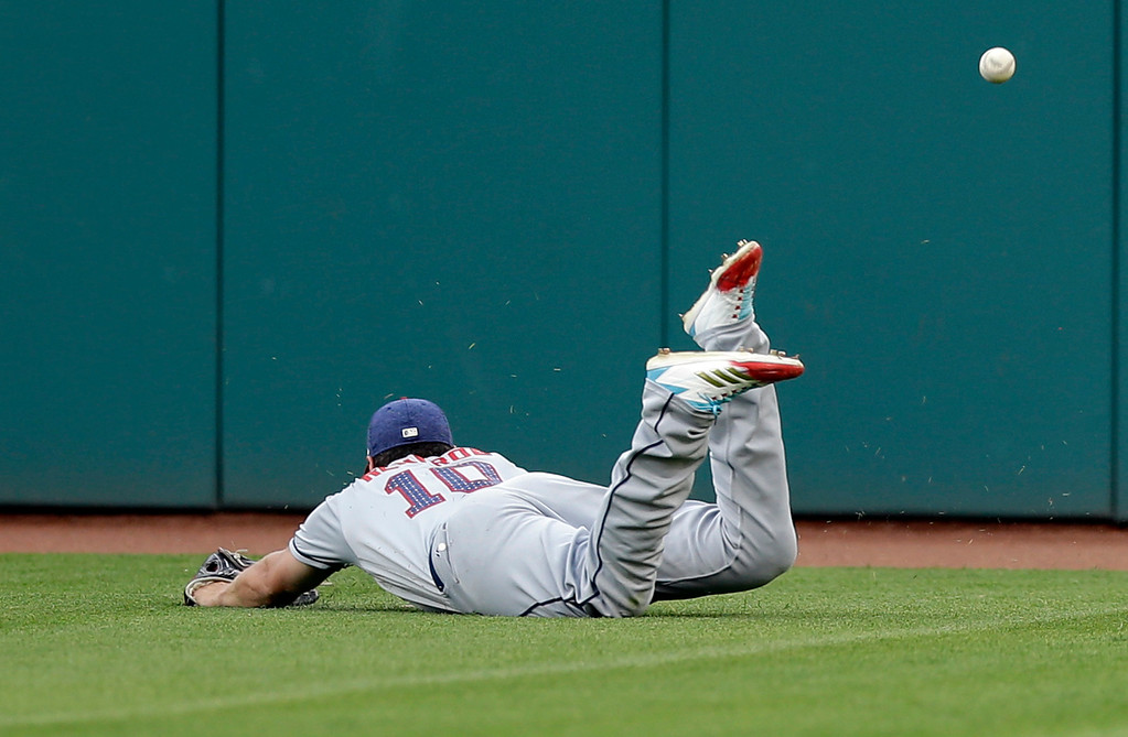 . San Diego Padres\' Hunter Renfroe dives for a triple hit by Cleveland Indians\' Jose Ramirez in the second inning of a baseball game, Tuesday, July 4, 2017, in Cleveland. (AP Photo/Tony Dejak)