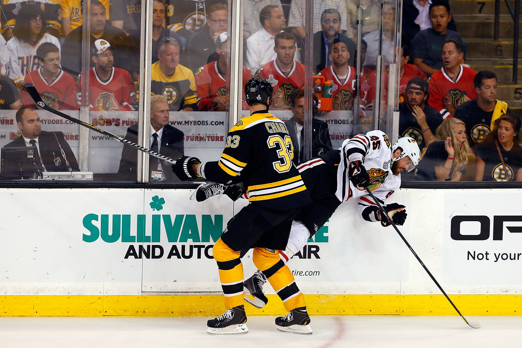 . Zdeno Chara #33 of the Boston Bruins checks Viktor Stalberg #25 of the Chicago Blackhawks in Game Six of the 2013 NHL Stanley Cup Final at TD Garden on June 24, 2013 in Boston, Massachusetts.  (Photo by Jim Rogash/Getty Images)