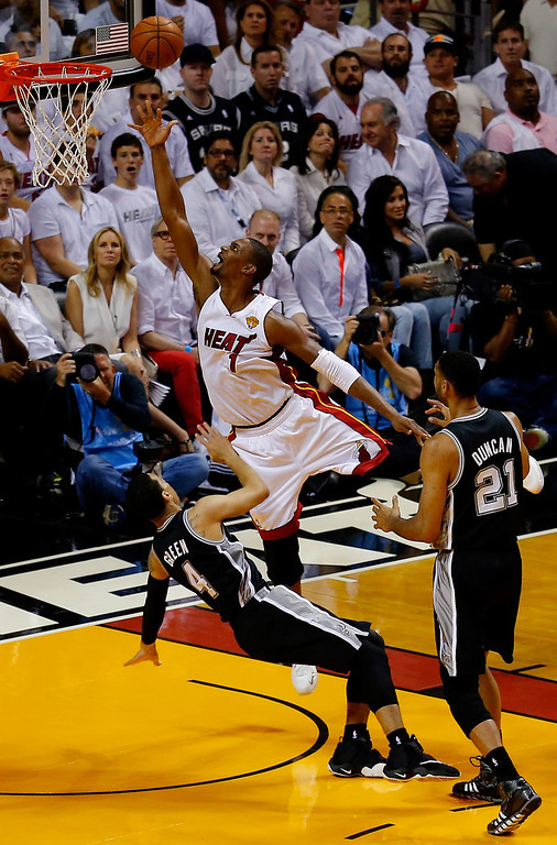 . MIAMI, FL - JUNE 12:  Chris Bosh #1 of the Miami Heat goes to the basket against Danny Green #4 of the San Antonio Spurs during Game Four of the 2014 NBA Finals at American Airlines Arena on June 12, 2014 in Miami, Florida. (Photo by Chris Trotman/Getty Images)