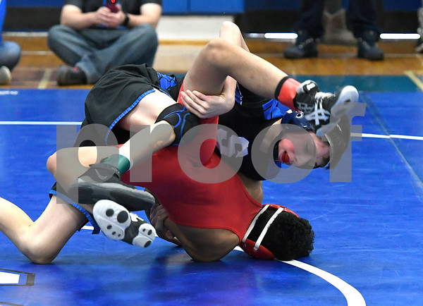 1/27/2018 MIke Orazzi | Staff Southington's Caleb Brick and Conard's Josh Ardon during the MASS-CONNfusion wrestling tournament at Southington High School Saturday.