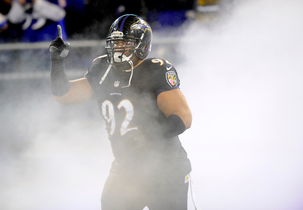 . Baltimore Ravens nose tackle Haloti Ngata enters the field before an NFL football game against the Pittsburgh Steelers, Thursday, Nov. 28, 2013, in Baltimore. (AP Photo/Nick Wass)