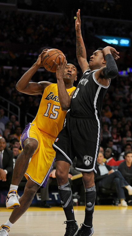 . Lakers Metta World Peace goes tot he hoop against MarShon Brooks in the 2nd quarter. The Lakers hosted the Brooklyn Nets in a game played at Staples Center in Los Angeles, CA. 11/19/12 (photos by John McCoy/Los Angeles Daily News)