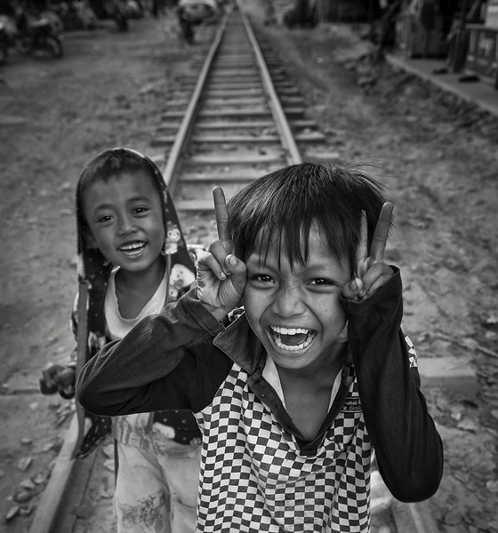 Boys playing on the rail tracks in the town of Meiktila.  Myanmar, 2017