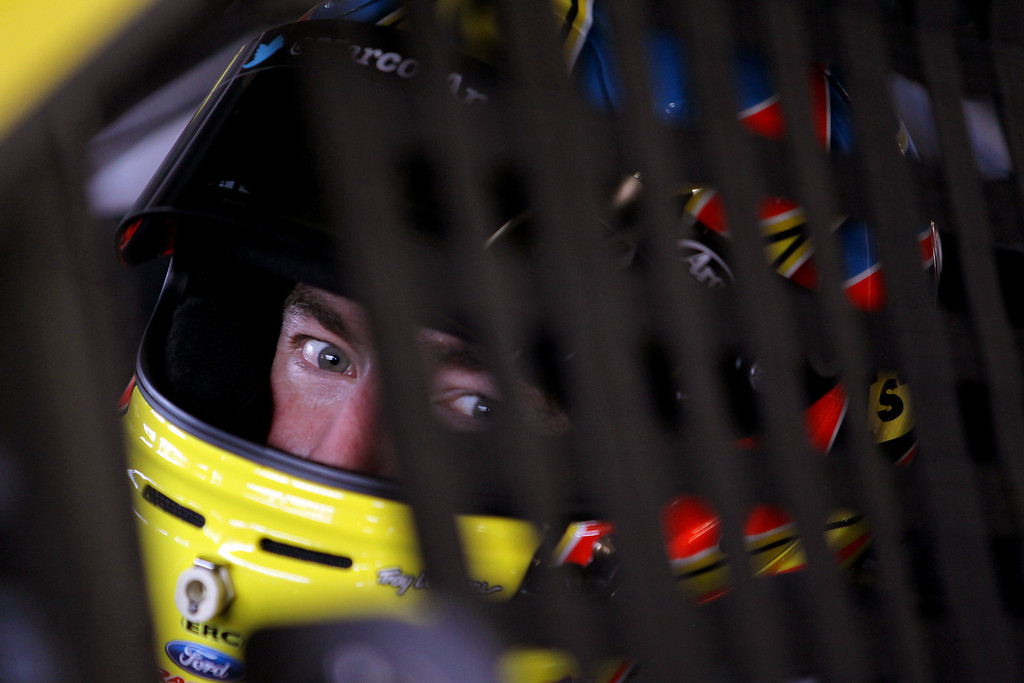 . DAYTONA BEACH, FL - FEBRUARY 20:  Marcos Ambrose, driver of the #9 Stanley Ford, sits in his car in the garage area during practice for the NASCAR Sprint Cup Series Daytona 500 at Daytona International Speedway on February 20, 2013 in Daytona Beach, Florida.  (Photo by Todd Warshaw/Getty Images)