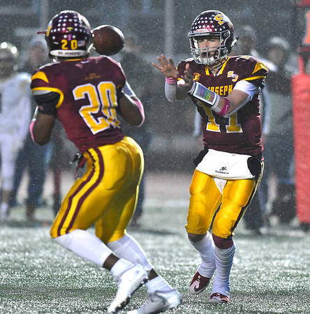 12/14/2019 Mike Orazzi | Staff St. Joseph High School's Jaden Shirden (20) and Jack Wallace (17) during a 17-13 win over Daniel Hand at Veteran's Stadium in New Britain on Saturday.