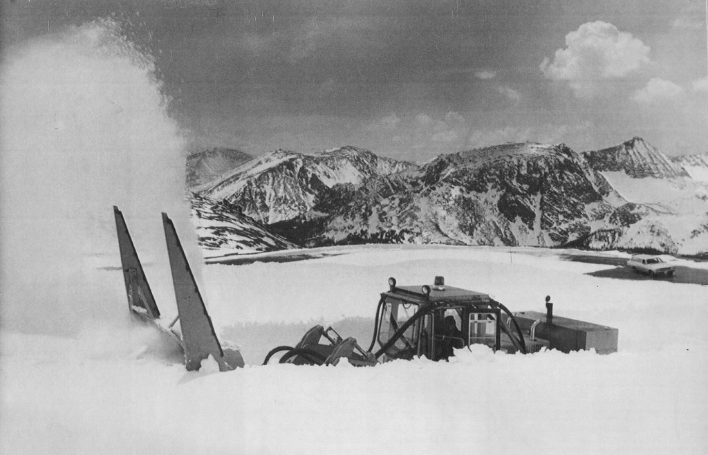 . A U.S. Park Service snow blaster cuts its way through a ten foot snow drift near the summit of Trail Ridge Road in Rocky Mountain National Park, 1979. In order to clear the 26 miles of roadway for Memorial Day, the park operates nine pieces of heavy equipment for 30 days moving at depths of 0 to 35 feet. Credit: AP Laserphoto