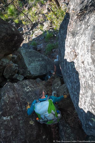 Zoltan scrambling down a steep chute