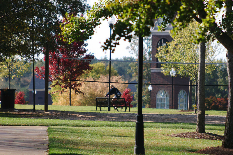 A Gardner-Webb University student bikes her way across campus on a Fall day.