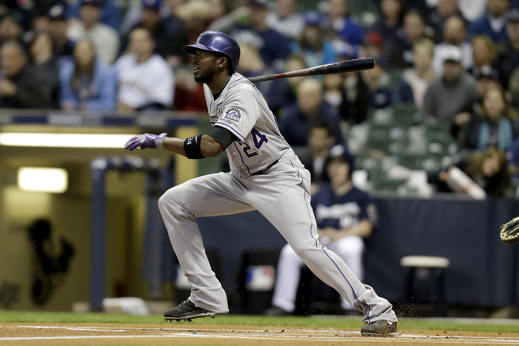 . MILWAUKEE, WI - APRIL 2: Dexter Fowler #24 of the Colorado Rockies reaches on an infield single in the top of the first inning against the Milwaukee Brewers at Miller Park on April 2, 2013 in Milwaukee, Wisconsin. (Photo by Mike McGinnis/Getty Images)